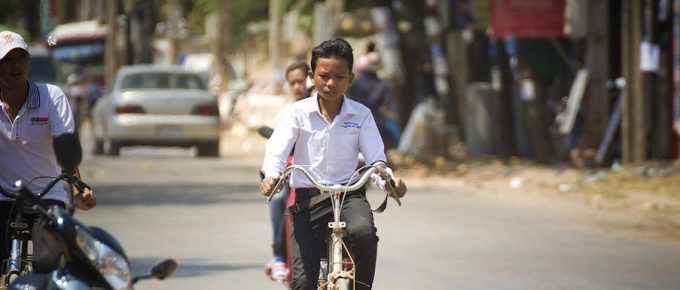 Cambodia Kid on bike